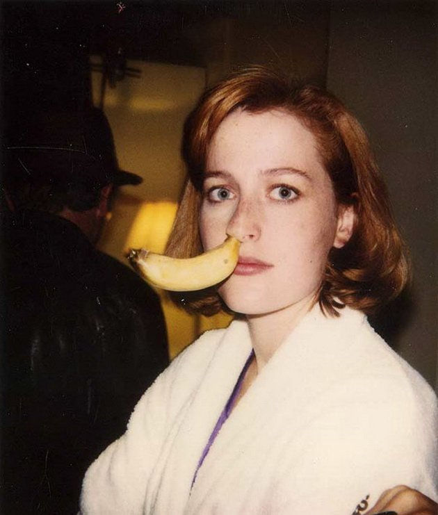 """11. Gillian Anderson with banana up her nose on the set of """"X-Files"""""""