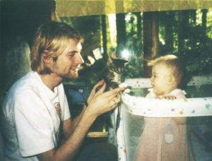 2. 26-year-old Kurt Cobain showing kitten to his daughter in 1993