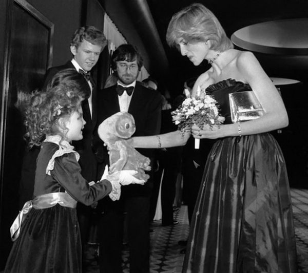 7. 7-year-old Drew Barrymore giving doll to princess Diana