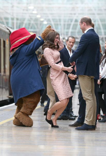 Catherine, Duchess of Cambridge dances with Paddington bear