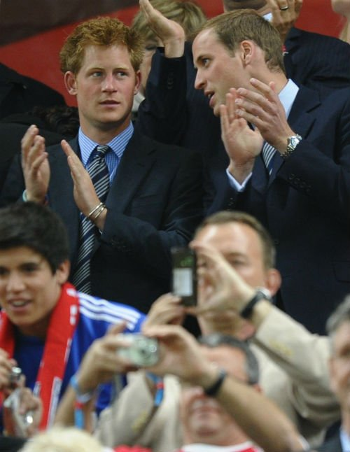 Prince Harry and Prince William at the Algeria v England match in 2010