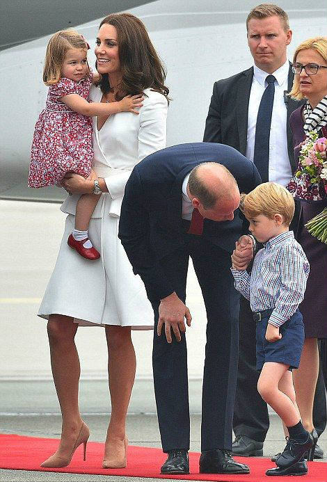 Prince George arrives in Poland with Kate and William