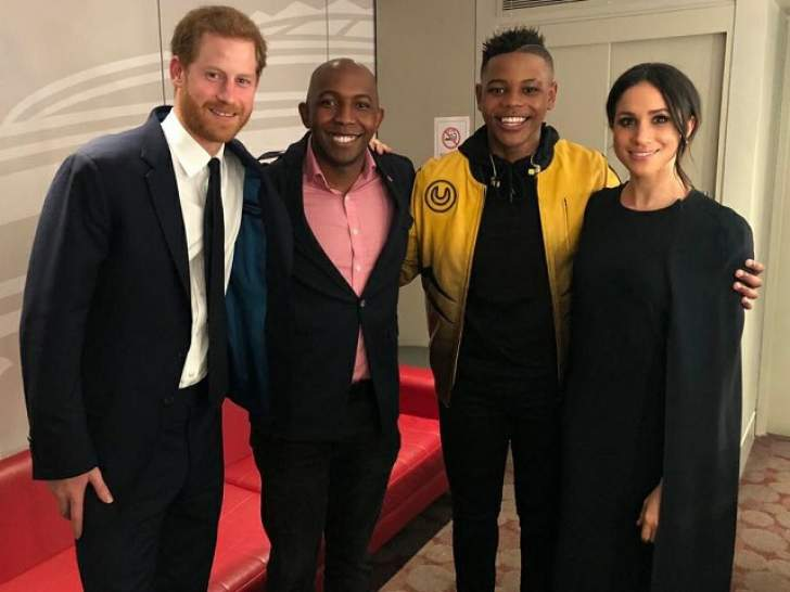 Donel Mangena with Prince Harry his father Nkosana and Meghan Markle