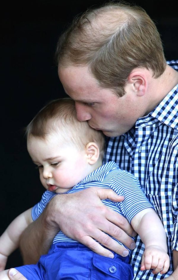Prince William kisses Prince George during a visit to the Taronga Zoo in Sydney, Australia