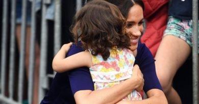 meghan hugs a girl