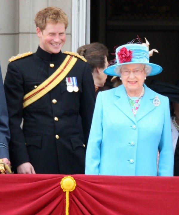 Prince Harry, Laughs next to HM Queen Elizabeth II