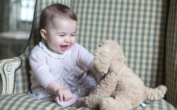 Princess Charlotte plays with a cuddly toy dog in a picture taken by Kate Middleton