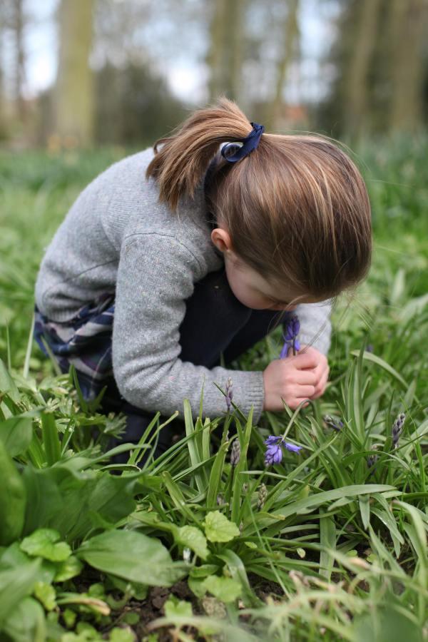 Princess Charlotte smelling flower