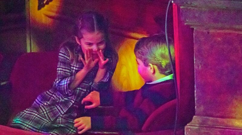 Prince George and Princess Charlotte chatting at London Palladium Unseen photo